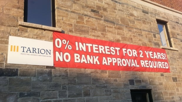 A sign on an infill house in a pricey area of West Toronto offers a deal. While the government looks for ways to cool an overheated property market, sellers are making it easier to buy.