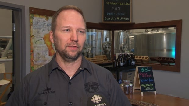 John vanDyk, co-owner fo Covered Bridge Brewing, can now sell dog biscuits thanks to new provincial regulations.