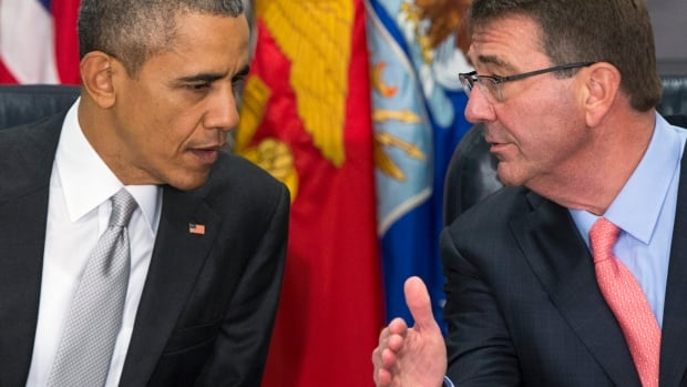 President Barack Obama talks with Defense Secretary Ash Carter during a meeting with the National Security Council about the fight against the Islamic State group, Monday, Dec. 14, 2015, at the Pentagon.