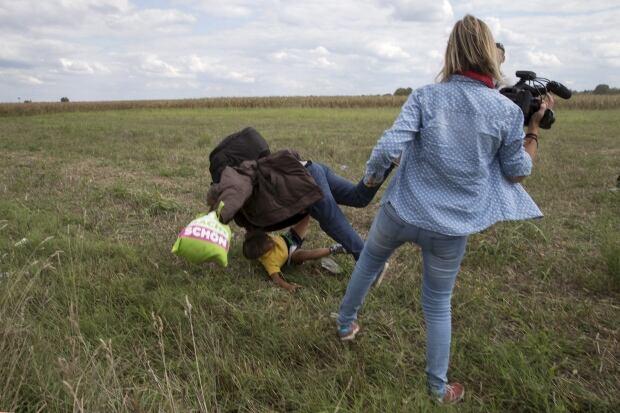 2015 photos of the year Hungarian journalist Petra Laszlo kicks migrants Sept 8