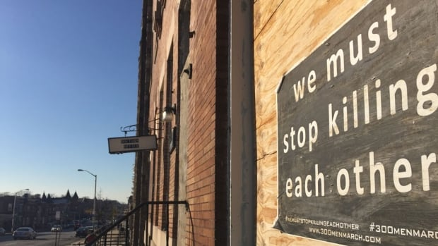 Posters urging an end to violence are plastered over abandoned buildings in West Baltimore's Sandtown-Winchester neighbourhood, where Freddie Gray lived. He died after sustaining a spinal injury while in police custody. His death sparked peaceful protests that turned violent the day of his funeral.