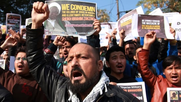 Muslims students in Jammu, India, carry placards and shout slogans Tuesday against the Nigerian government against the killings of hundreds of Shia Muslims and the detention of their leader, Ibraheem Zakzaky, in Nigeria.