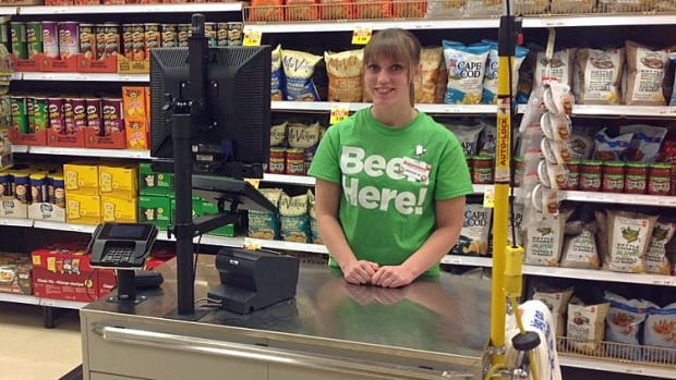 "Certified cashiers wear green shirts that read ""Beer Here,"" indicating to shoppers at which tills they can pay for alcohol."