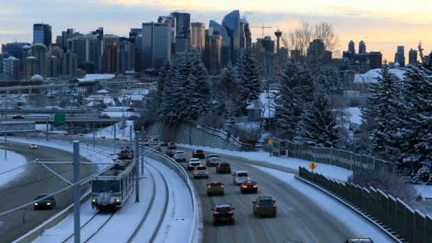 Major routes like Memorial Drive were mostly plowed for the morning commute, but driving was still slippery.