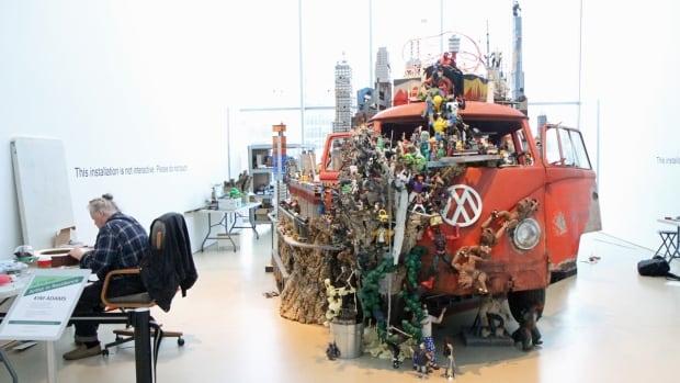 Artist Kim Adams works on new additions for his sculpture, Bruegel-Bosch Bus.
