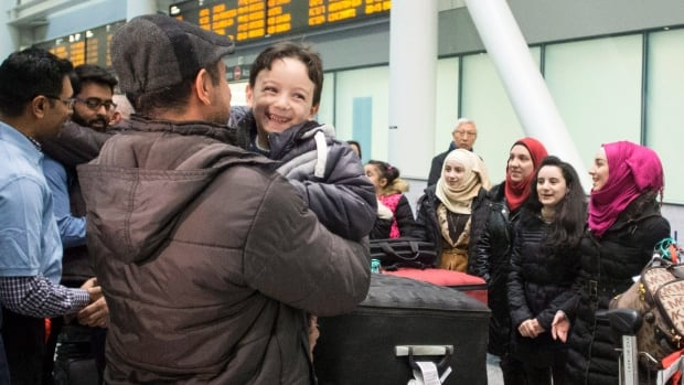 Refugees from Syria greet each other and family and friends at Toronto's Pearson Airport on Dec. 9. Planes are now beginning to arrive daily, bringing the need for affordable places to house the new arrivals.