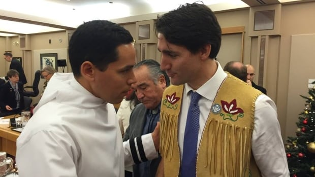 Natan Obed, president of Inuit Tapiriit Kanatami, shakes hands with Prime Minister Justin Trudeau after a Truth and Reconciliation Commission meeting in Ottawa in December. Obed says Tuesday's meeting between Inuit leaders and the prime minister 'shows a great sense of respect that the Canadian government is giving to Inuit.'