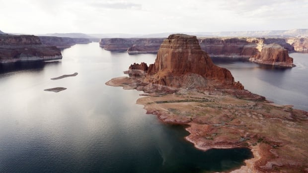 Dry land that would be under water when the lake is full is seen next to Gregory Butte in Lake Powell near Page, Ariz., on May 26, 2015.
