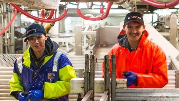 Crew inside the processing area of Baffin Fisheries Coalition vessel, the MV Sivullik.