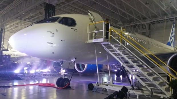 A CS100 model is shown in Bombardier's hangar in Mirabel Quebec. The company received certification for the next-generation jet on Friday.