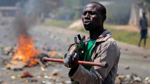An opposition demonstrator points a mock gun made from wood towards soldiers and tells them it is shameful to shoot on people who cannot defend themselves, in the Ngagara neighborhood of the capital Bujumbura, in Burundi in June 2015. Demonstrators opposed to President Pierre Nkurunziza have been met with violence in Burundi, where at least 400 people have been killed since the spring.