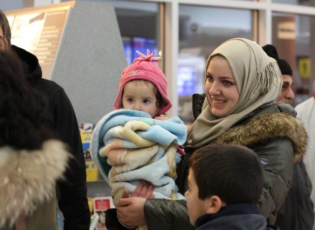 Saskatoon - Syria Refugees - Mom and child