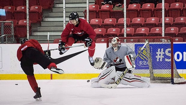 Goalie Mackenzie Blackwood, right, is seen during a Canadian world junior team practice in Toronto Dec. 11.