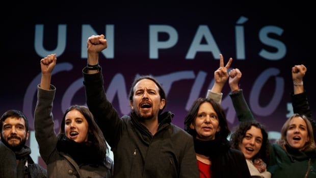 Podemos party leader Pablo Iglesias, centre, and other party leaders celebrate as general election results began to roll in confirming the newcomer on the political scene looked set to capture 68 seats and a chance of forming a coalition in parliament.