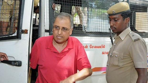 Subhash Kapoor, a Manhattan art dealer, is shown here being brought to court in Ariyalur, India, in 2012, charged with the theft of two ancient idols. U.S. investigators have confiscated over 2,600 artifacts valued at over $150 million from Kapoor's warehouses.