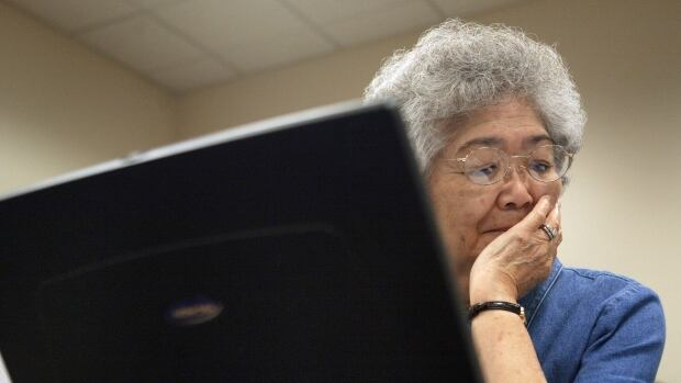 "Mitzi Takehara works on her laptop an ""Introduction to MS Word"""