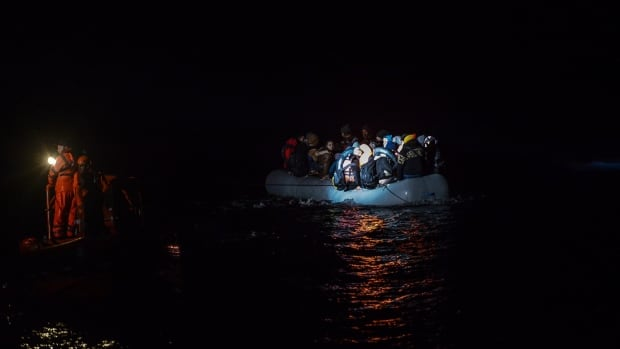 A rescues of migrants aboard an inflatable dinghy is seen in a file photo on the Aegean Sea on Dec. 10.