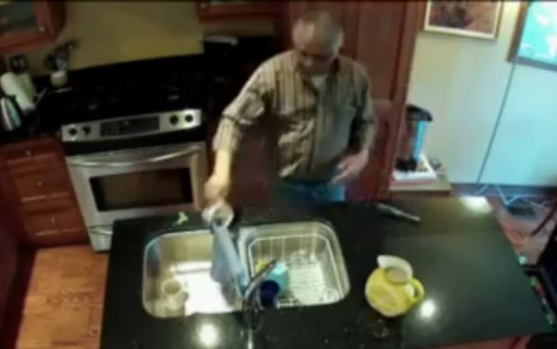 Jerry Bance pours mug into sink