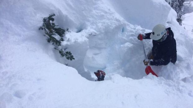 Snowboarder Colin Watt had a close call Saturday when an avalanche buried him in a tree well and he had to be dug out.