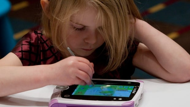 A young girl plays on the Leapfrog Leappad in a 2011 photo. LeapFrog, maker of the toy-like LeapPad, released its first Android tablet this year.