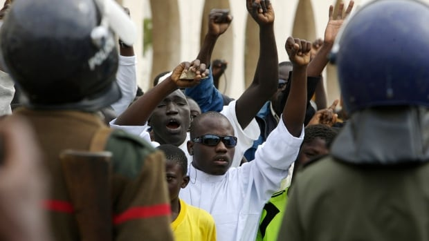 In this archive photo from 2008, anti-gay protesters are seen outside of Dakar's main mosque protesting a magazine's publication of images from a gay wedding. Homosexuality is illegal in the mostly Muslim nation of Senegal.