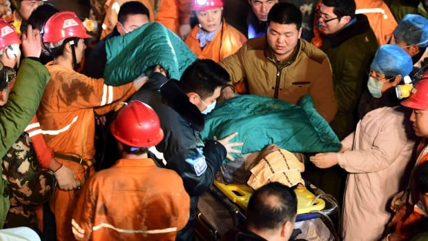A trapped miner is rescued from a collapsed gypsum mine in Pingyi County, in east China's Shandong province.