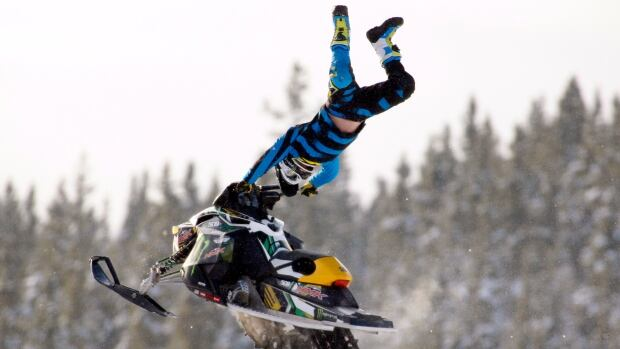 Alberta's Tourism minister wants to open up more backcountry for snowmobiling - like this freestyle competition rider - and other snow and river sports to be more aggressive about marketing the province's wild treasures.