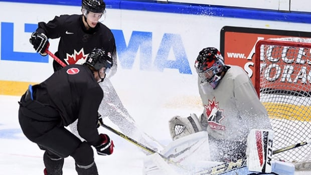 Canadian goaltender Mackenzie Blackwood practices with teammates Thomas Chabot, top left, and Roland McKeown during the world junior championship in Helsinki, Finland on Sunday. Canada plays Demark Monday at 1 p.m. ET.