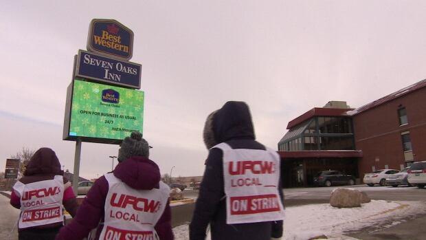 Restaurant and hotel staff walk the picket line on Albert Street in Regina.
