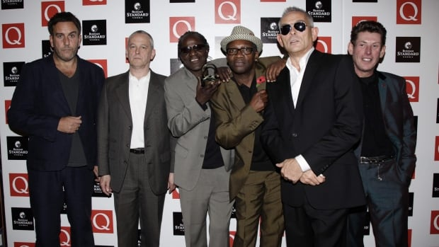 British band, the Specials from left, Terry Hall, Horace Panter, Neville Staple, Lynval Golding, John Bradbury and Roddy Byers, pose for a photo at an awards show in London in 2009.