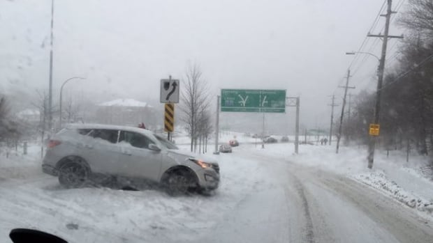 A Halifax driver lost control of their SUV in heavy snow at Armdale roundabout, sliding off the road.