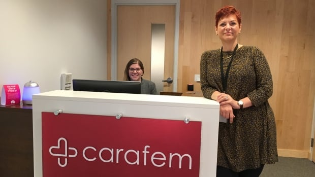 Carafem VP of health services Melissa Grant, standing, is shown from the abortion provider's flagship office in the Friendship Heights neighbourhood near Washington, D.C. The first Carafem centre opened in April and aims to 'de-medicalize' women's reproductive health care.