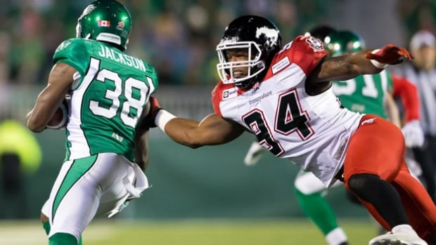 Defensive lineman Frank Beltre, right, who would have become a free agent in February, has re-signed with the Calgary Stampeders.