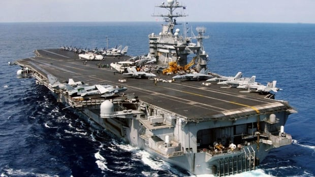The American aircraft carrier USS Harry S. Truman was entering the Persian Gulf when Iran's Revolutionary Guards fire missiles, a navy spokesman said.