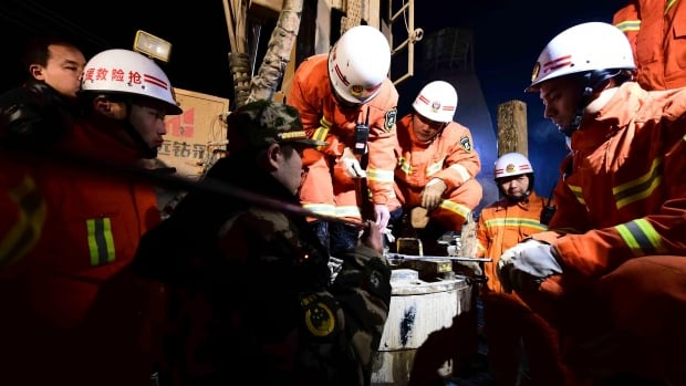 In this Dec. 28, 2015 photo provided by China's Xinhua News Agency, rescuers try to contact the trapped people at a collapsed mine in Pingyi County, east China's Shandong Province.