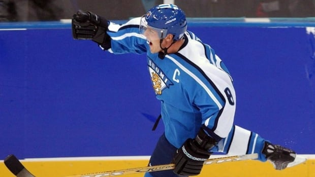 Teemu Selanne, captain of the Finnish national team, shown after scoring a goal against Russia in the 2002 Olympics in Salt Lake City, had his No. 8 jersey retired by the national team in a ceremony at the World Junior Hockey Championship in Helsinki, Finland.