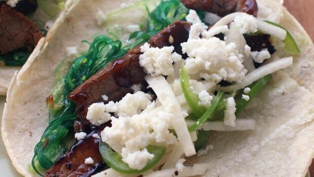 Several food trend prognosticators say 'seaweed is the new kale.' This July 27, 2015 photo shows beefy seaweed tacos with jalapeno jicama slaw, from a recipe by J.M. Hirsch.