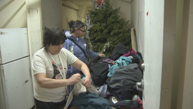 Lion Hotel tenants sort through clothing and blankets donated after the heat went out at the Downtown Eastside building.