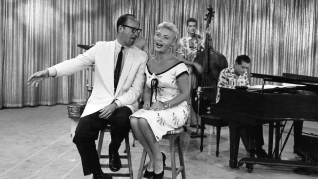 "Dal Richards, left, and Lorraine McAllister with the Chris Gage Trio on CBUT's ""Meet Lorraine"" ca. 1958. The City of Vancouver passed a motion to name a Vancouver street after the late band leader."