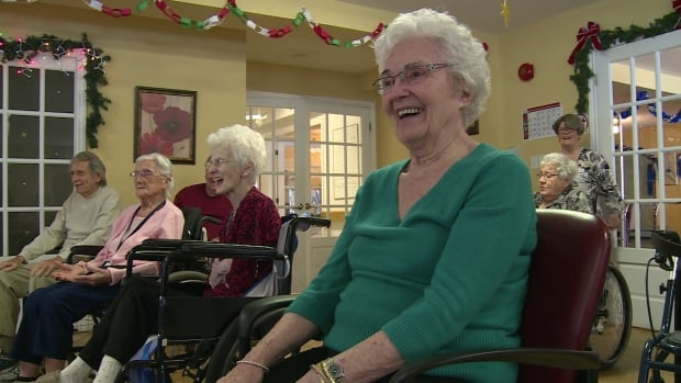 Seniors laughter yoga class at Whisperwood Villa