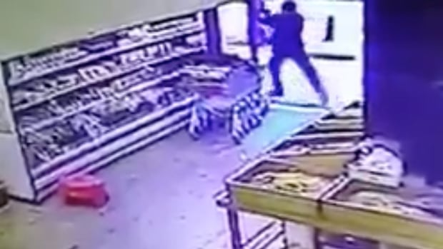 A still image taken from CCTV footage shared online purports to show the moment a gunman opened fire at a popular bar in the central Israeli city of Tel Aviv on New Year's Day, killing two and wounding at least three others before fleeing.