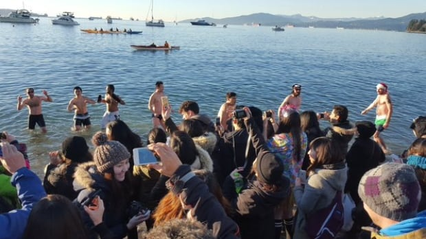 Thousands braved the cold to take part in the Annual Polar Bear Swim at English Bay on the first day of 2016.