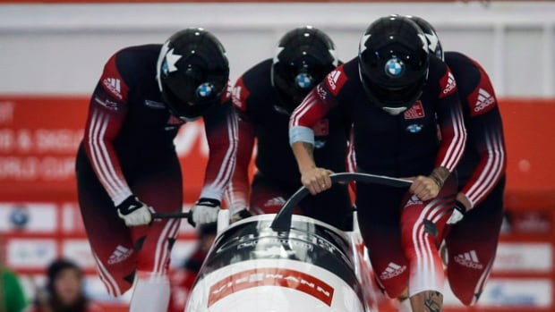 Canada's Kaillie Humphries, Dan Dale, Joey Nemet, and Douglas McLelland, compete in the men's World Cup 4-man bobsled event in Calgary on Dec. 20, 2014.