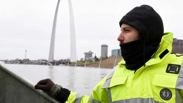 U.S. Geological Survey hydro technician Jason Carron assesses the Mississippi River flood waters in St. Louis, Mo., Dec. 31, 2015.