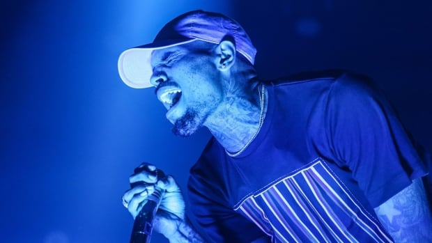 Chris Brown, seen here performing in L.A. in Dec. 2015, is being investigated by police for an allegation of battery at Las Vegas's Palms Casino Resort filed Jan. 2.