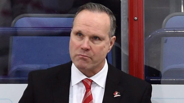 "Canada's head coach Dave Lowry reacts to his team's 6-5 quarter-final loss to host Finland at the world junior hockey championship in Helsinki on Saturday. Hockey Canada threw its support behind Lowry and his staff, saying ""there is a point in time where that transfer of responsibility goes from the coach to the player."" The sixth-place finish is Canada's lowest at the tourney since 1998."