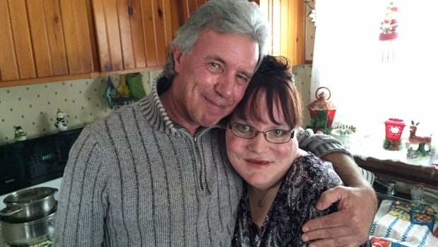 Adoption rights advocate Mike Slayter (left) paid for Pam Harper's plane ticket from Alberta to Nova Scotia so she could reconnect with her son.