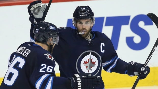 Winnipeg Jets' Andrew Ladd (16) and Blake Wheeler (26) celebrate Ladd's goal against the Toronto Maple Leafs during third period NHL action in Winnipeg on December 2, 2015.