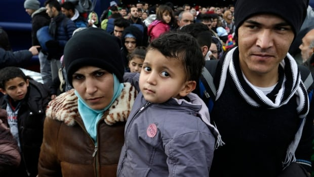 People disembark from a ferry after their arrival from the Greek eastern Aegean islands to the Athens' port of Piraeus, on Monday. Greece's coast guard have been rescued hundreds people since the start of the new year in various incidents on the Aegean Sea as migrants keep trying to enter the European Union despite the cold and rough seas.