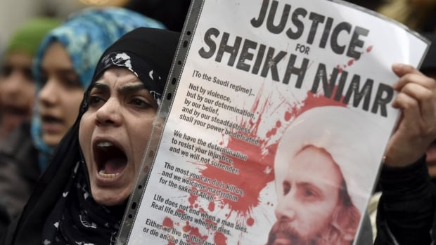 Protesters denounce Saudi Arabia's execution of Shia cleric Sheikh Nimr al-Nimr outside the Saudi Embassy in London on Monday. Documents obtained by CBC News suggest that at the time of al-Nimr's sentencing in 2014, Canadian diplomats did not expect Saudi Arabia to carry out the death sentence.
